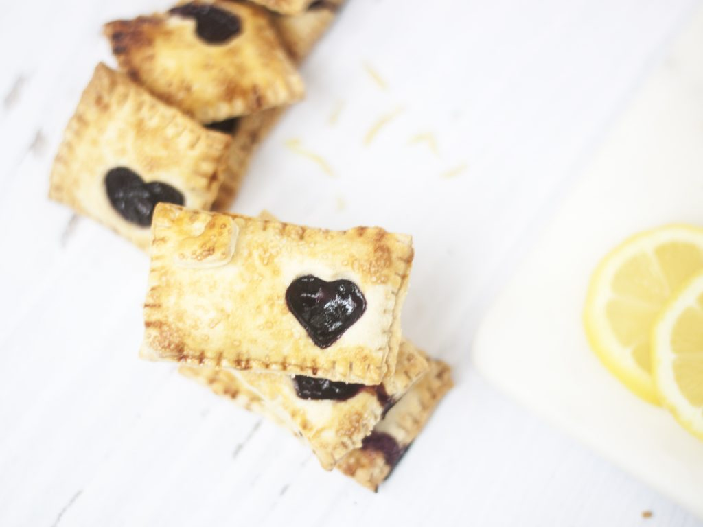stacked Blueberry and Lemon Hand Pies on a white background