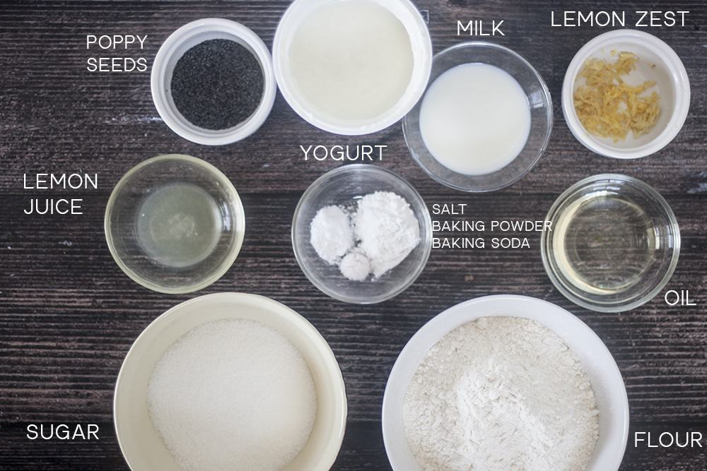 Ingredients for Eggless Lemon Poppyseed Yogurt Muffins on a brown background