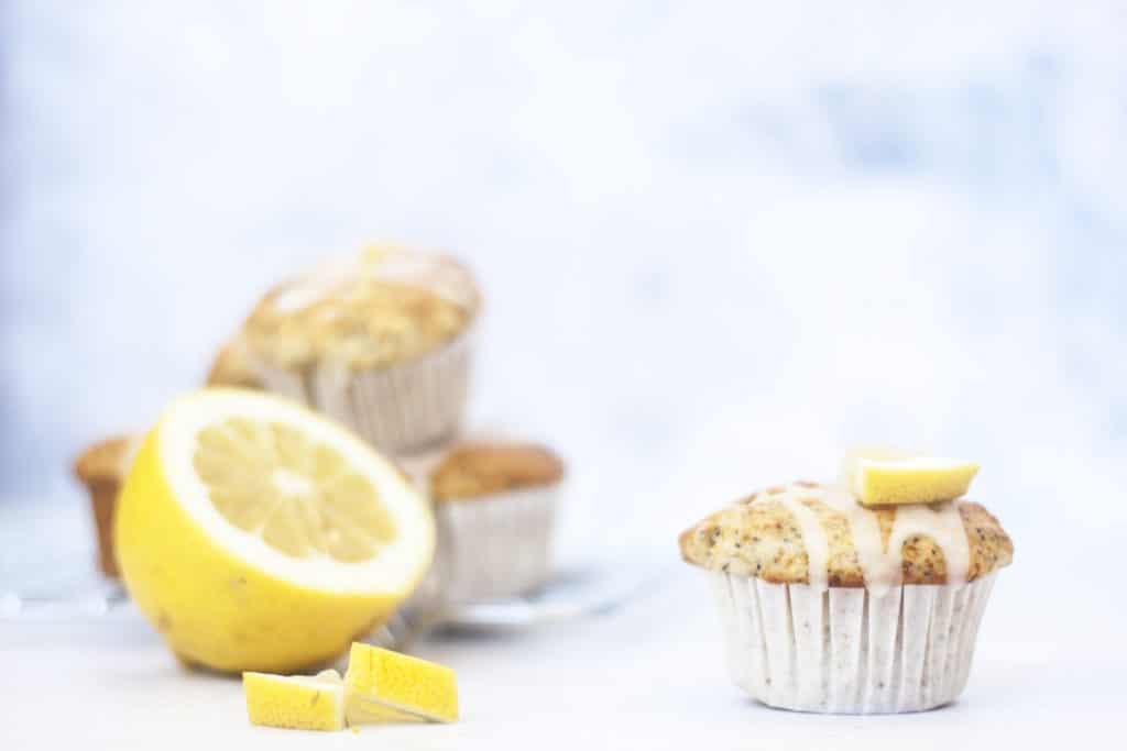 Eggless Lemon Poppyseed Yogurt Muffins on a white background