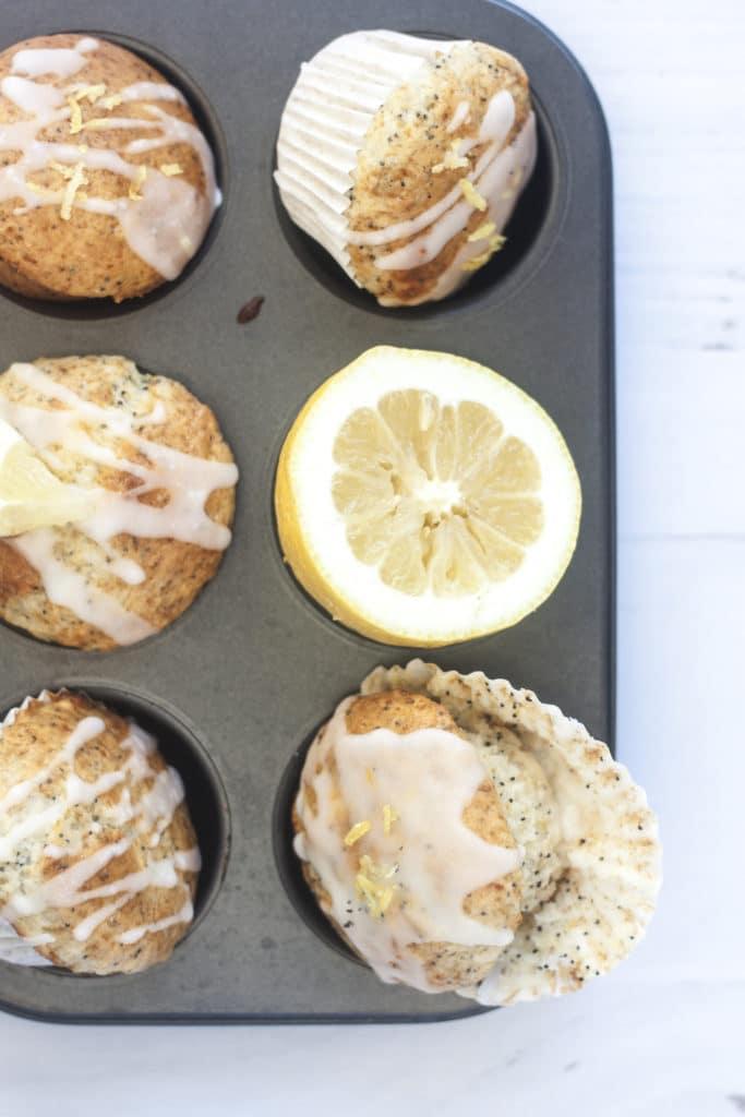 Eggless Lemon Poppyseed Yogurt Muffins in muffin tin on a white background