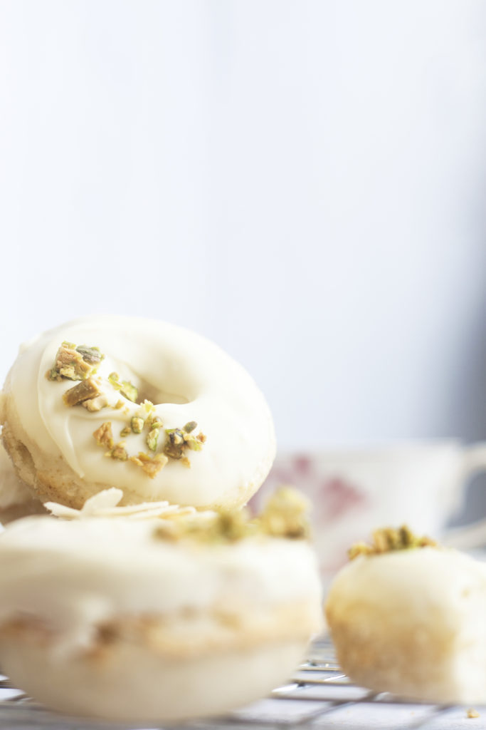 vertical image of White Chocolate Ricotta Donuts