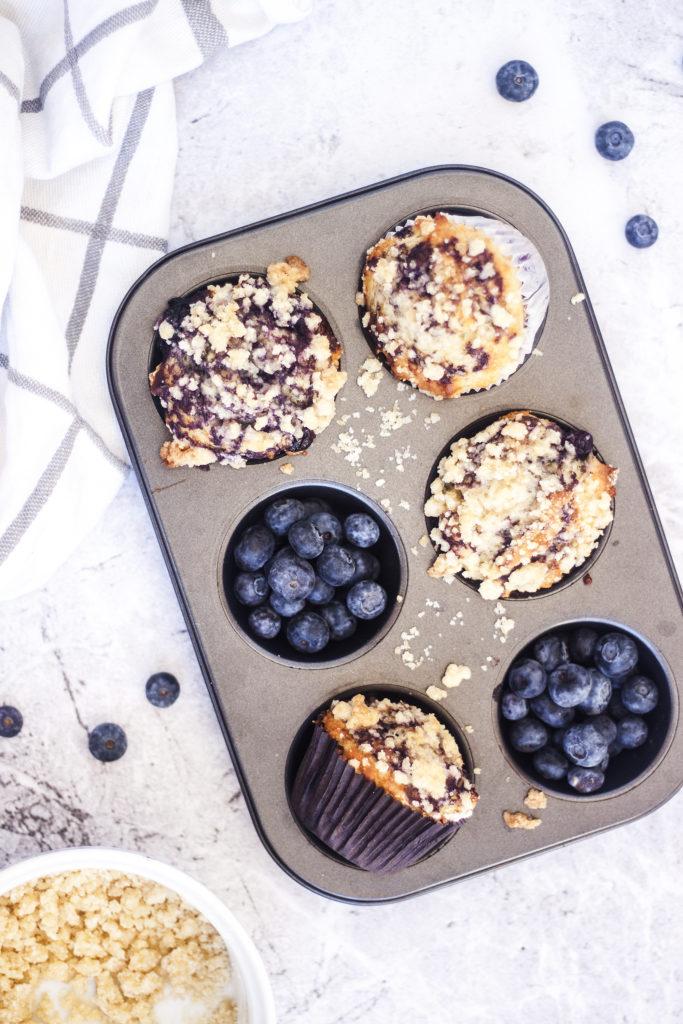 Eggless Blueberry Swirl Yogurt Muffins in muffin tin