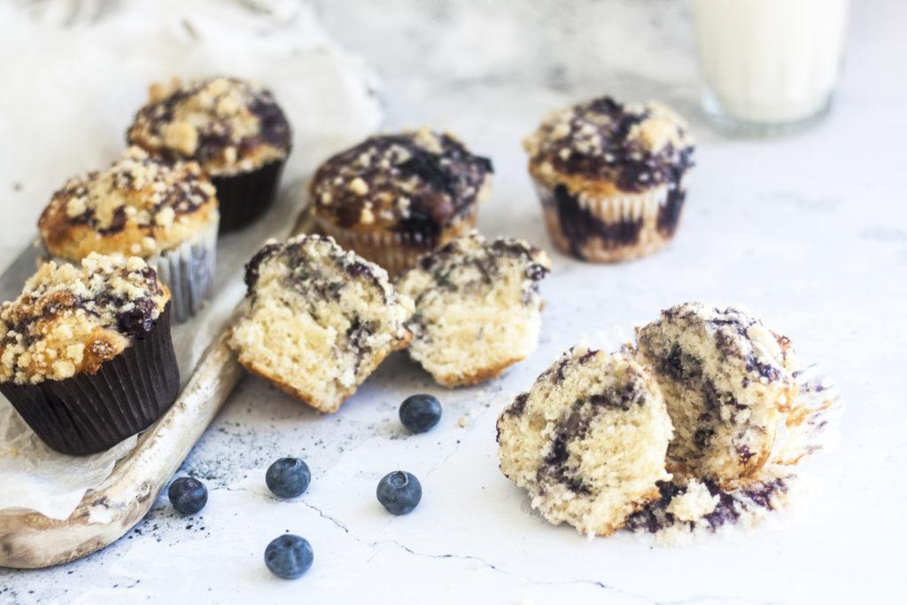Eggless Blueberry Swirl Yogurt Muffins on white background