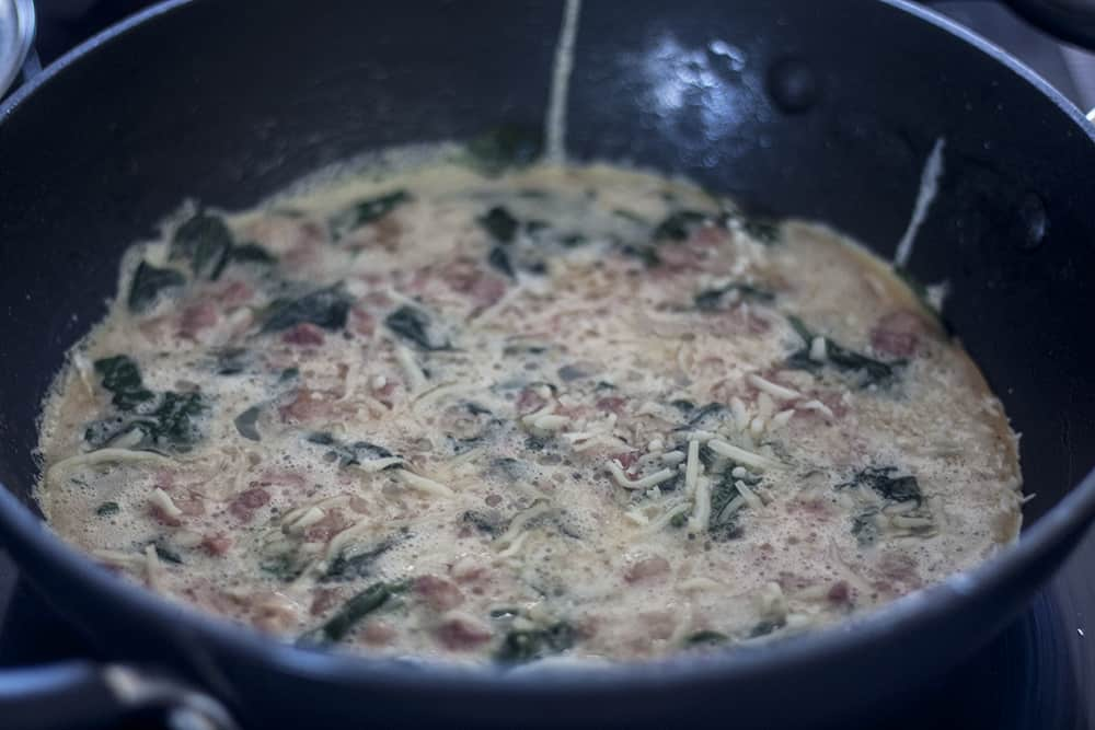 Pancetta Spinach and Cheese Frittata in skillet on stovetop
