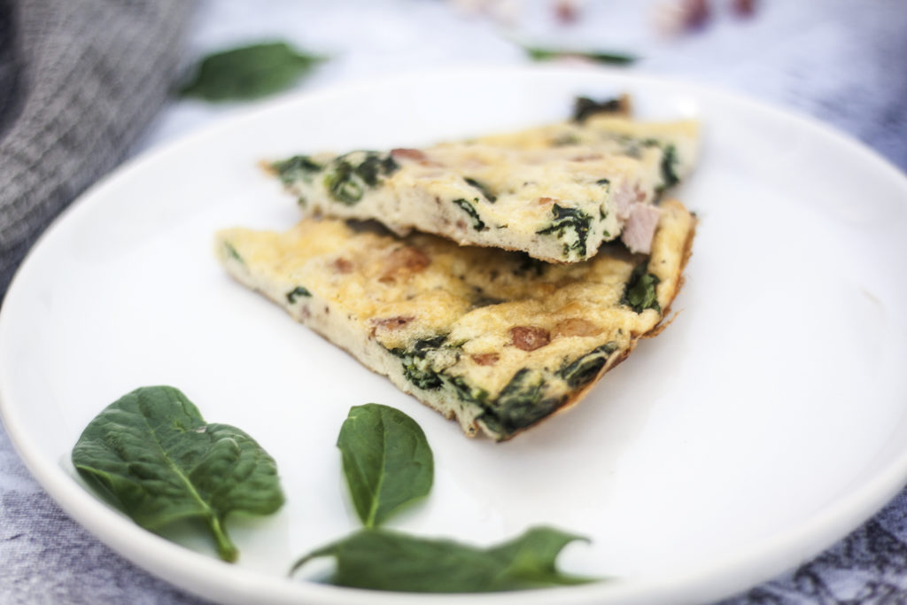Pancetta Spinach and Cheese Frittata two slices on a white plate