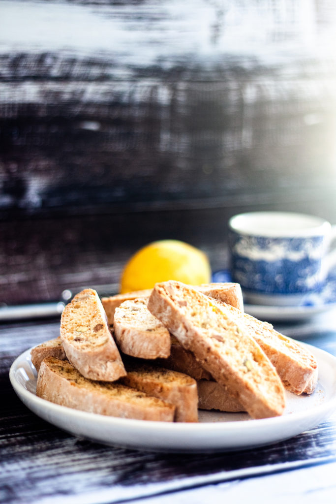 Pistachio Lemon Biscotti stacked on a plate