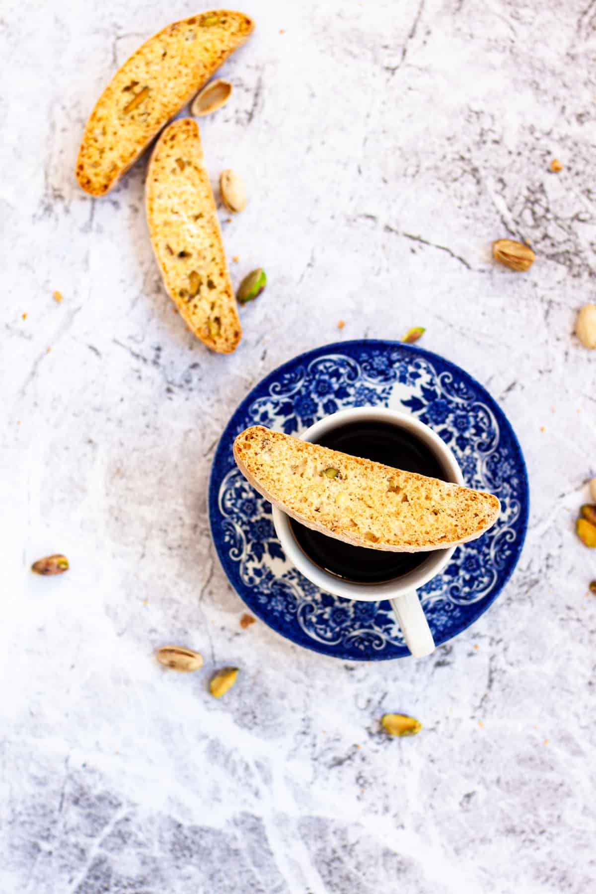 Pistachio Lemon Biscotti on a cup of coffee