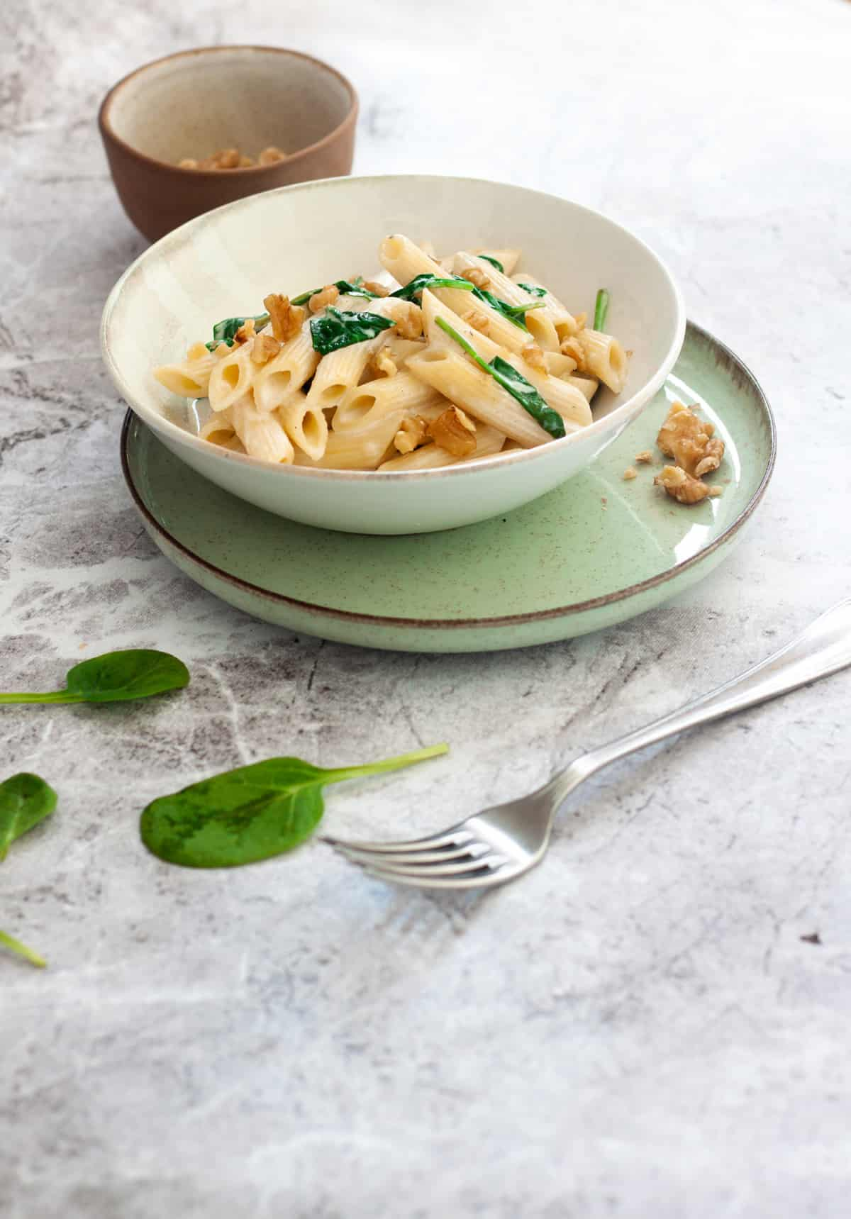 plate of creamy spinach and walnut pasta