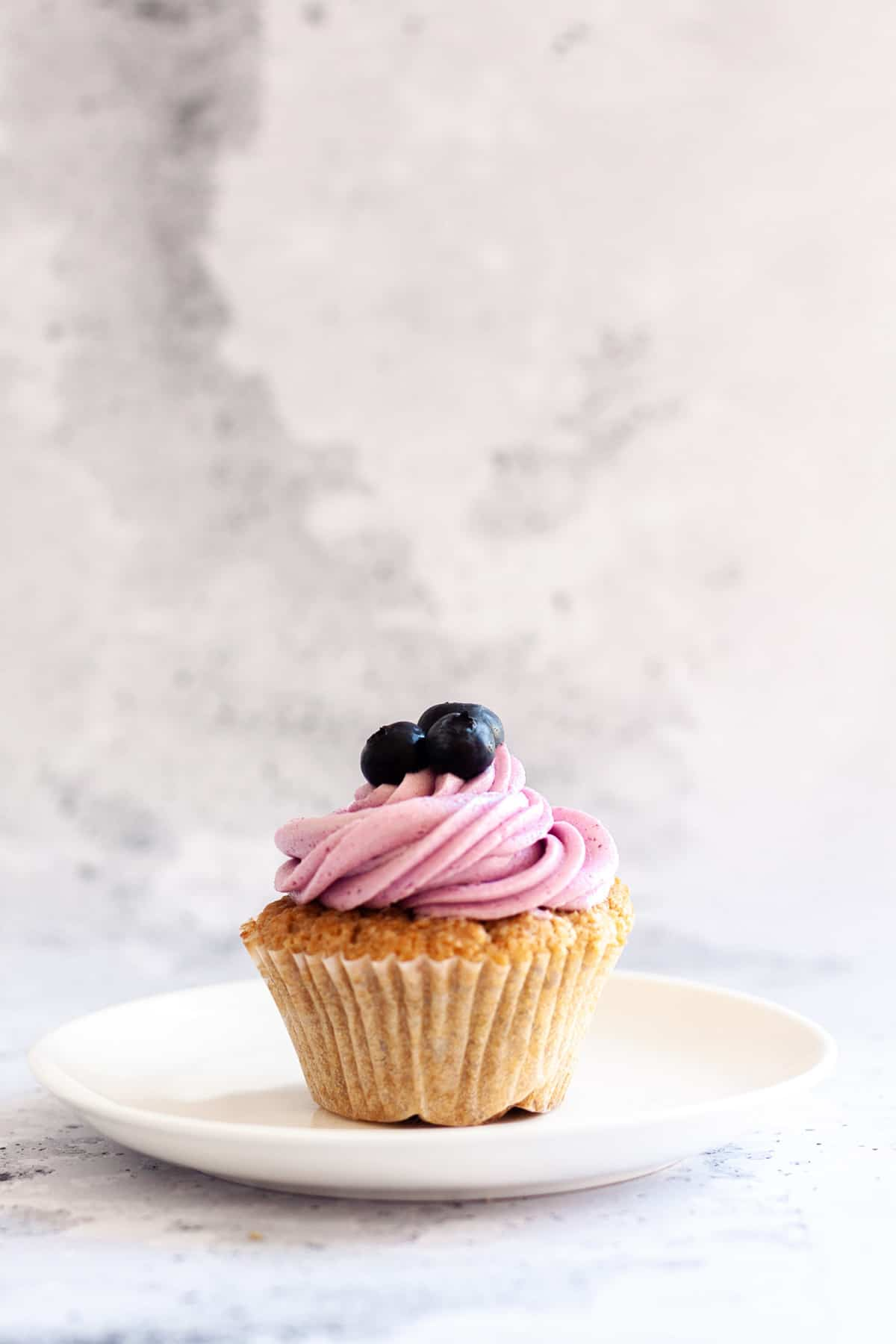 one Earl Grey Cupcakes with Blueberry Frosting