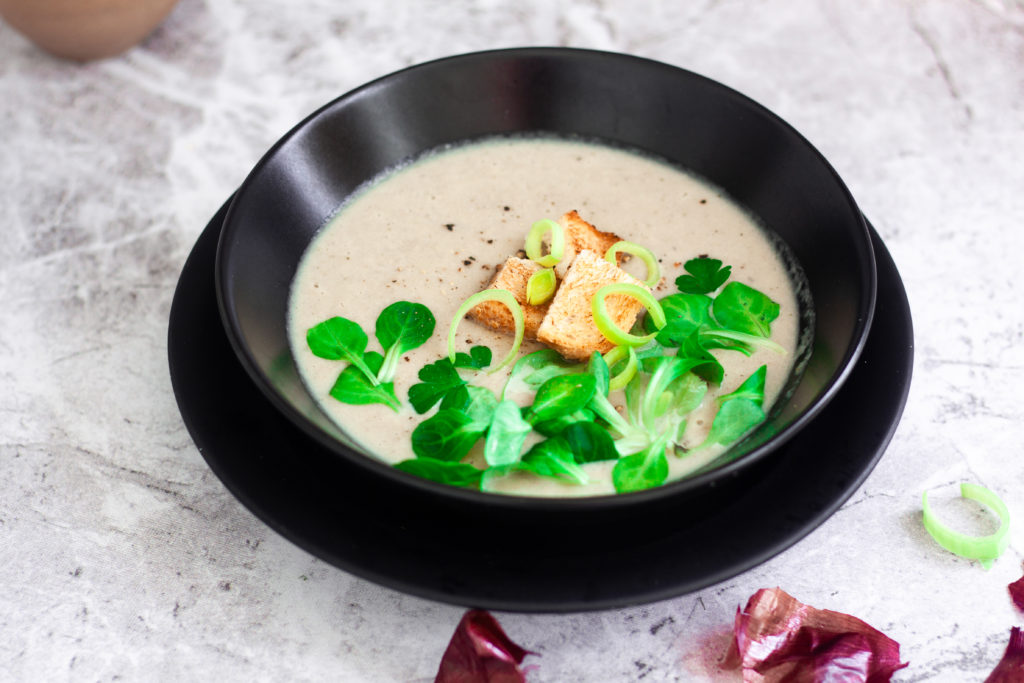 Shallot and Leek Soup in black plate