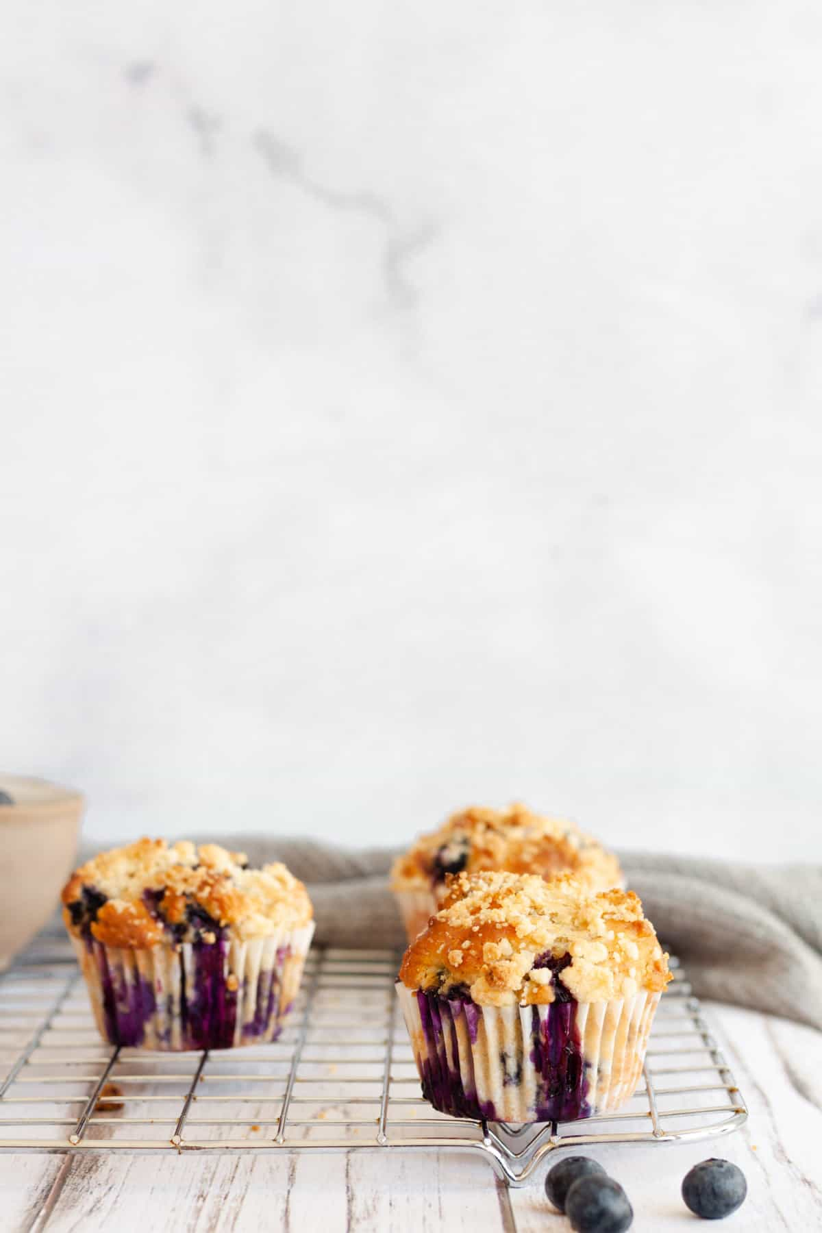 Blueberry Earl Grey Muffins on a white background