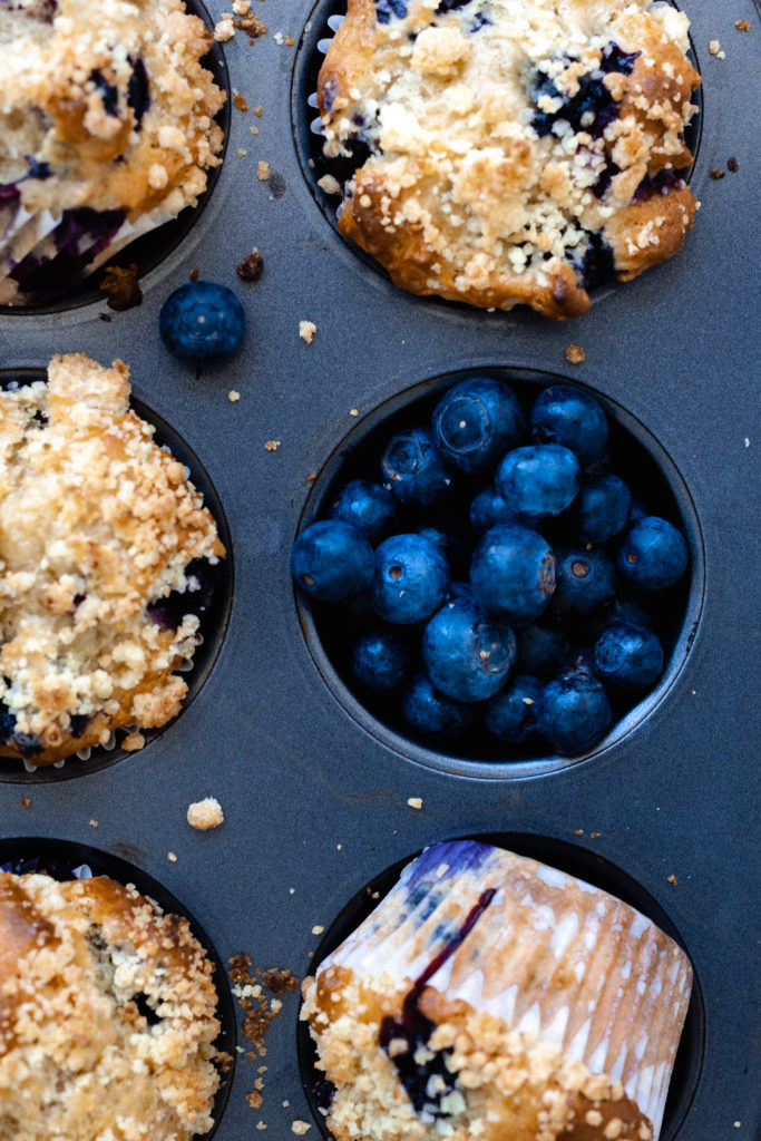 Blueberry Earl Grey Muffins and blueberries in muffin tin