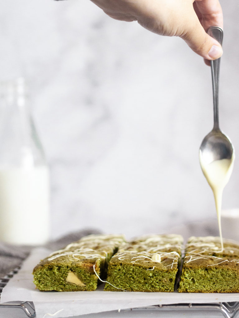 glazing green matcha brownies with melted white chocolate