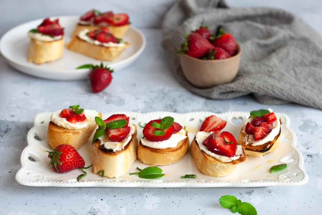 strawberry mascarpone bruschetta on white tray