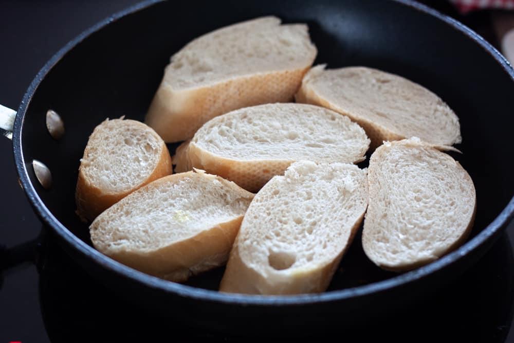 heating bruschetta in skillet