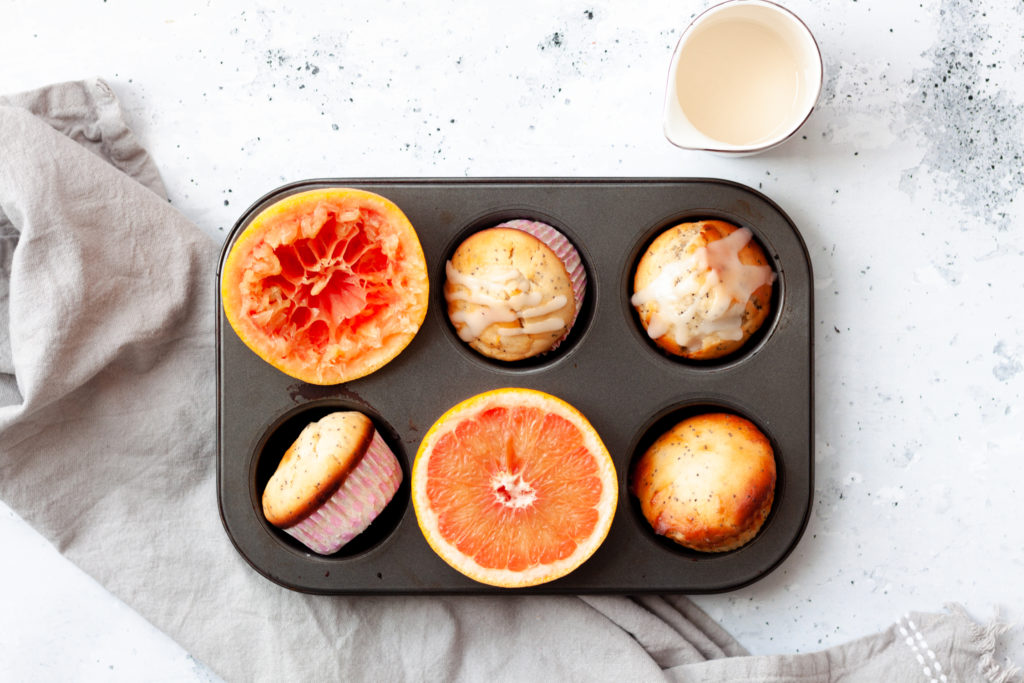 grapefruit yogurt muffins in muffin pan