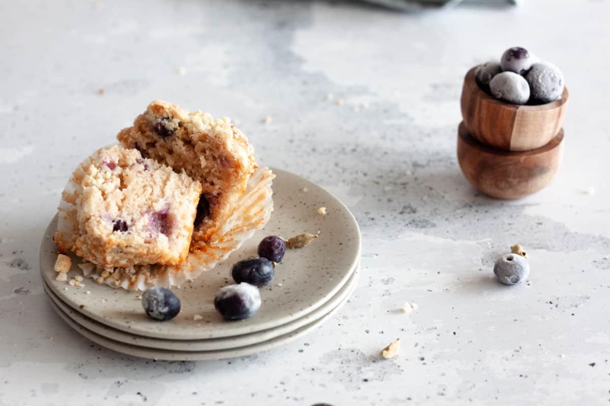 a blueberry cardamom muffin cut in half