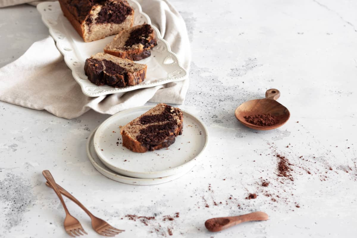 a slice of Chocolate Banana Marble Loaf Cake on a dessert plate