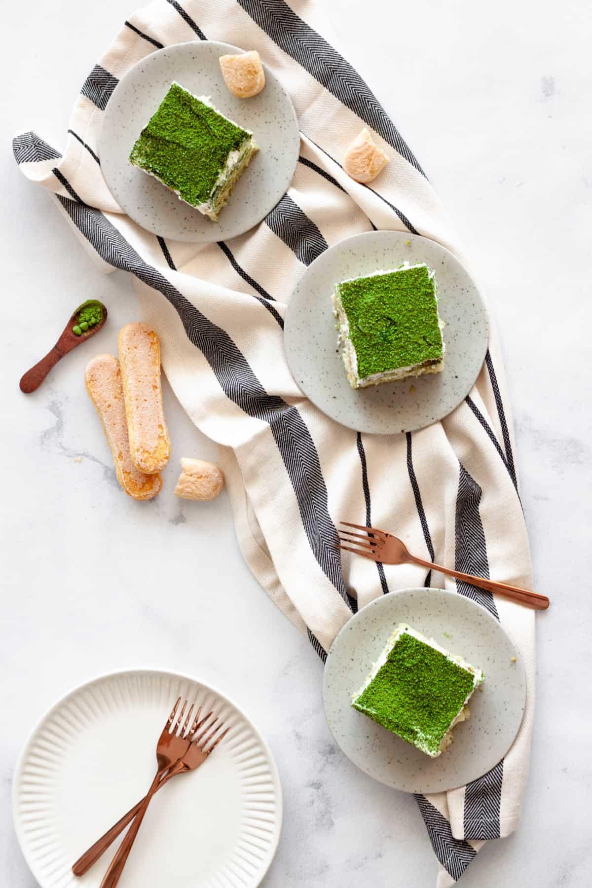 vertical image of three servings of matcha tiramisu