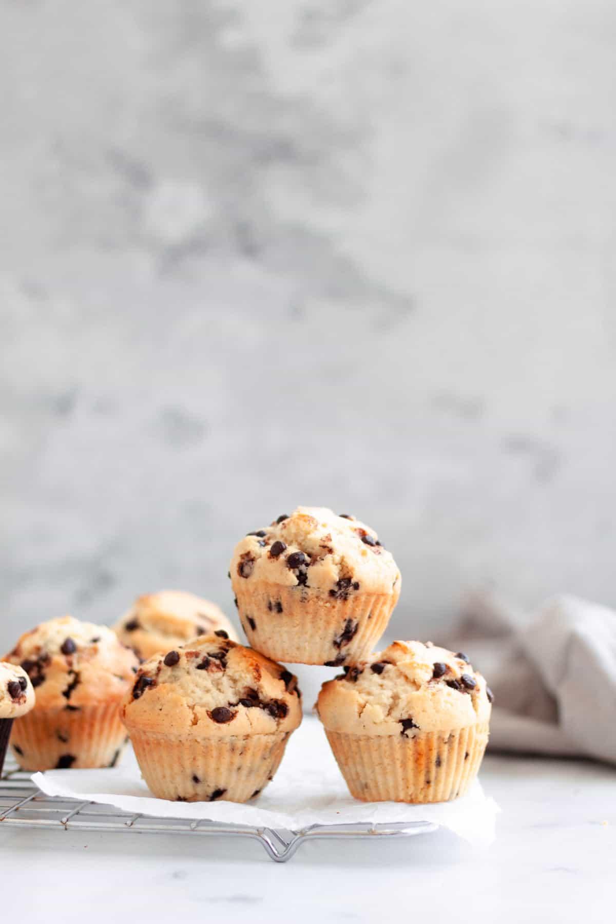three stacked Vegan Chocolate Chip Muffins