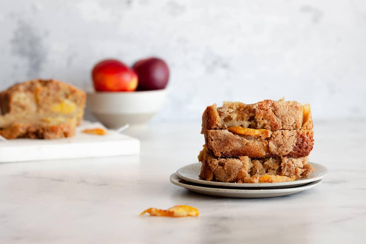 three slices of peach cobbler cake