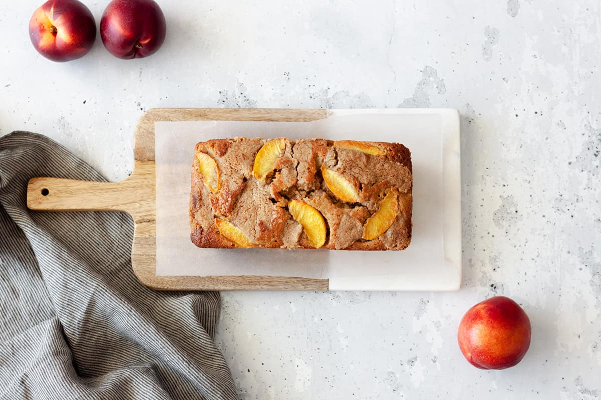 Peach Cobbler Pound Cake on a wooden serving board.