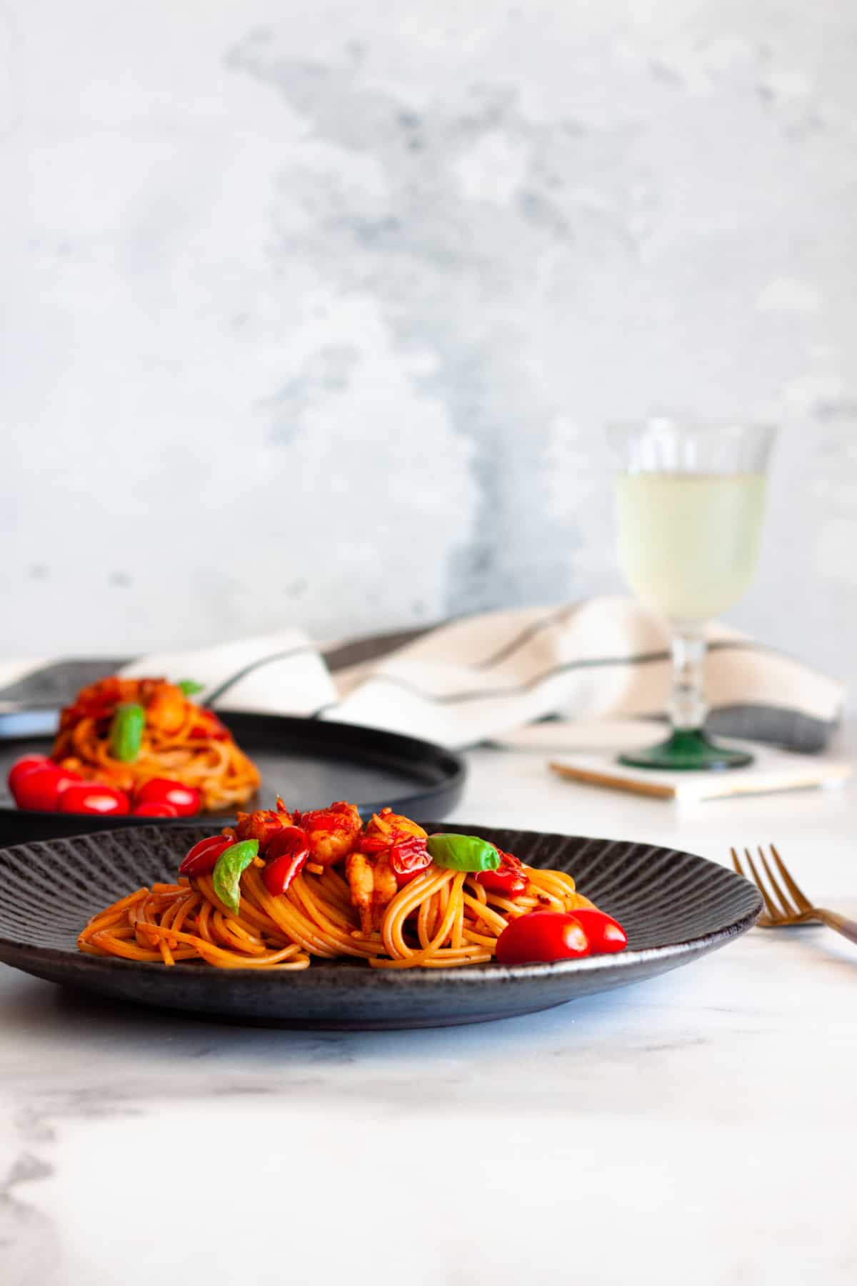 two servings of pasta with prawn bisque sauce