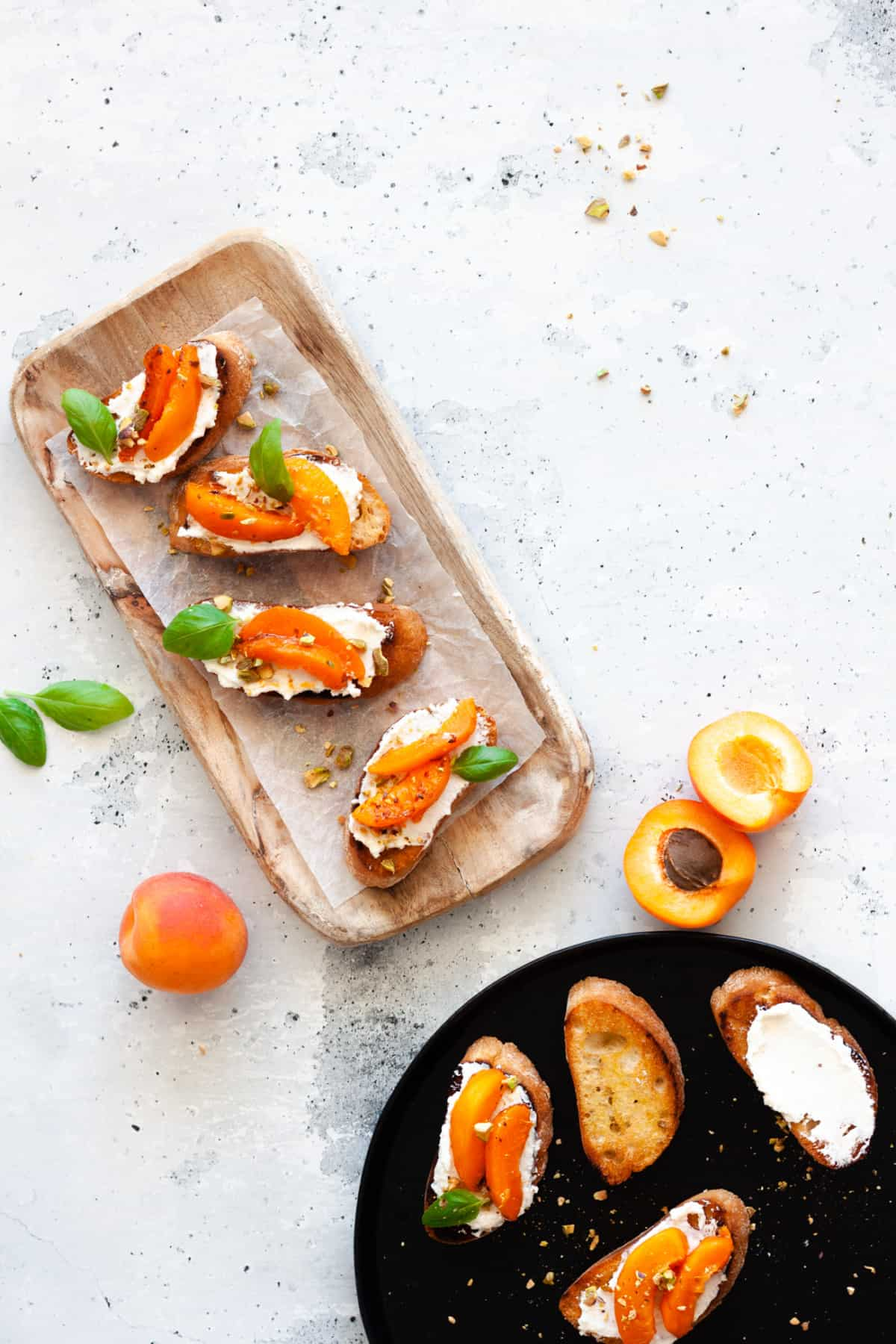 whipped ricotta crostini with sliced apricots and fresh basil leaves