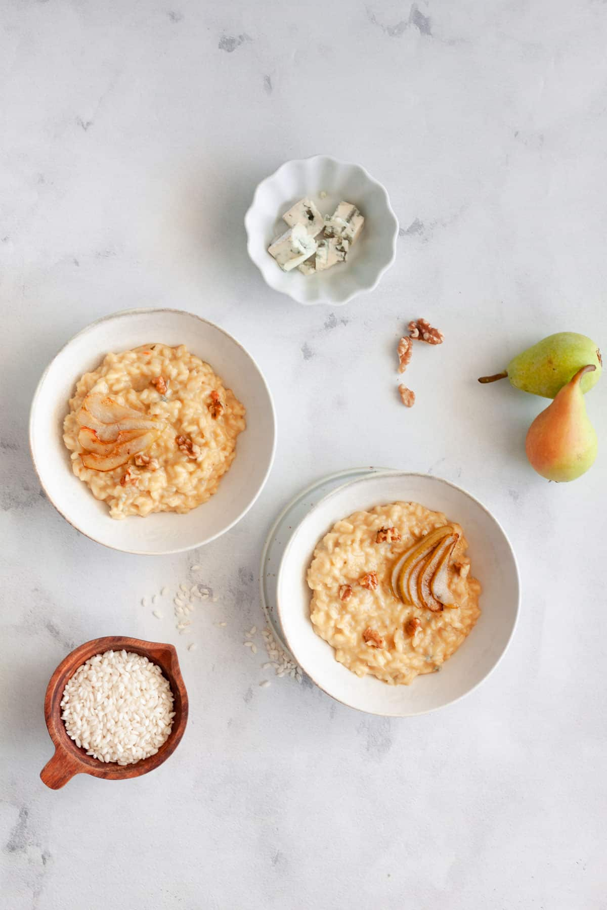 two servings of gorgonzola risotto on a white background