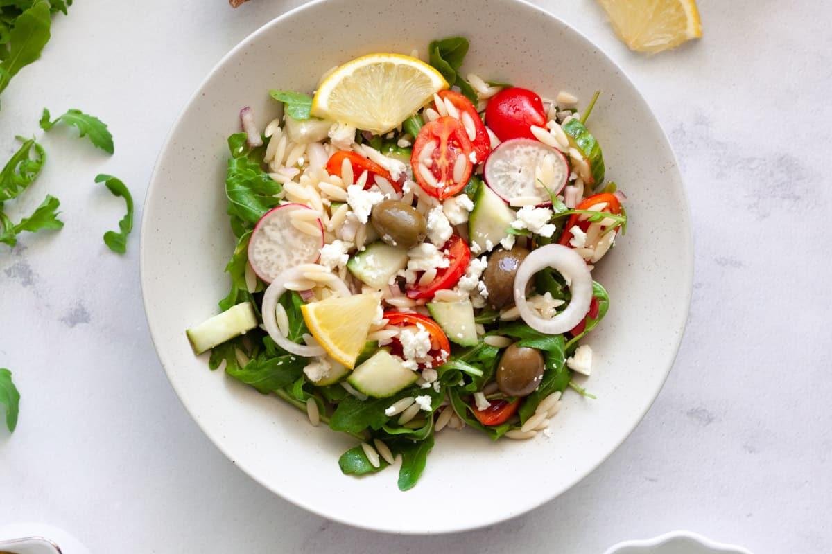lemon orozo salad in serving plate