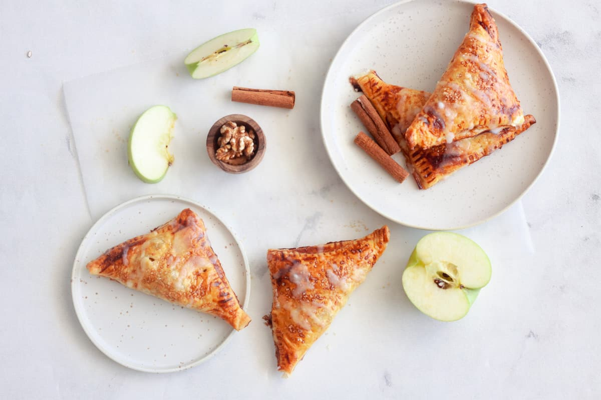 four servings of puff pastry apple turnovers