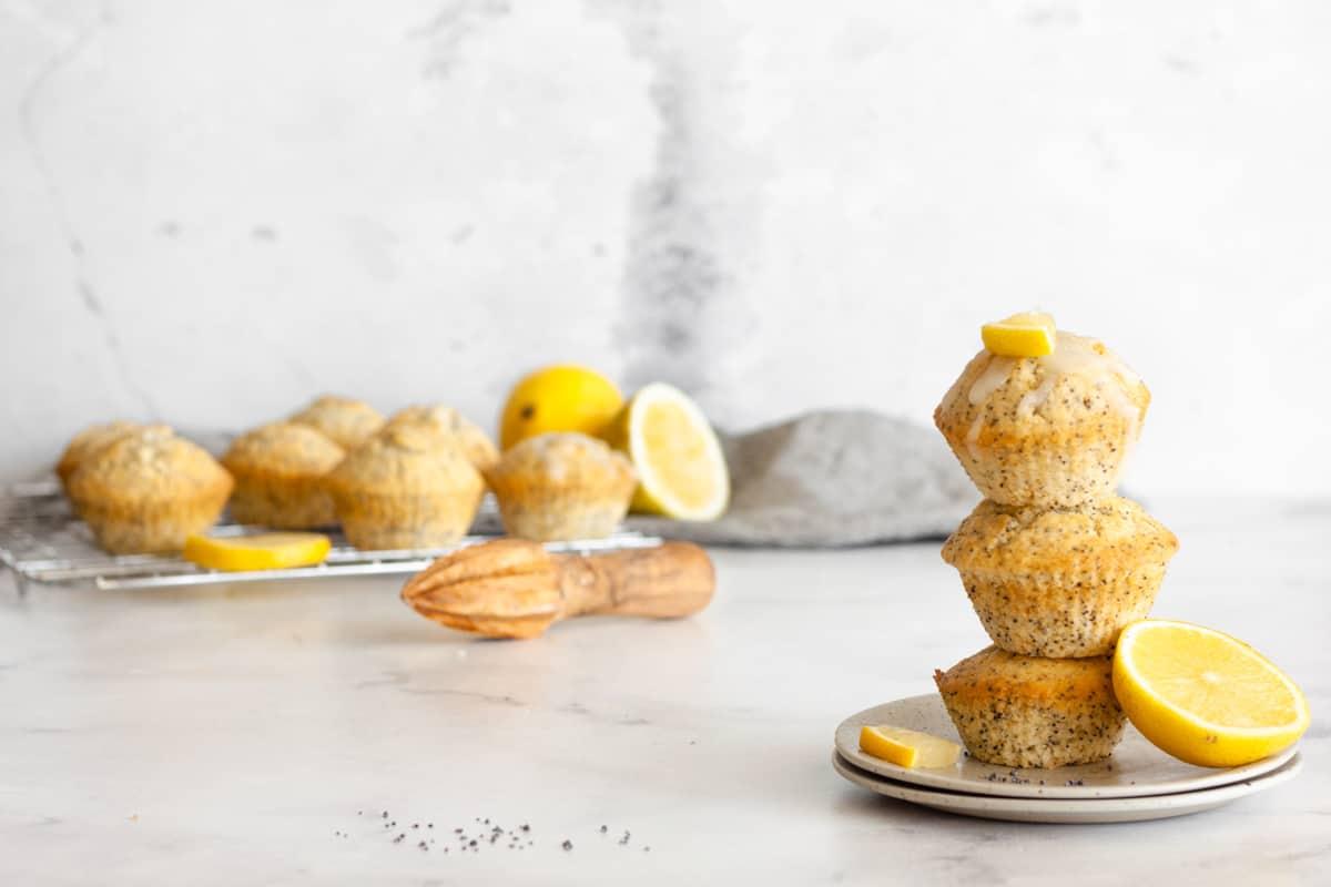 a stack of 3 vegan lemon poppyseed muffins