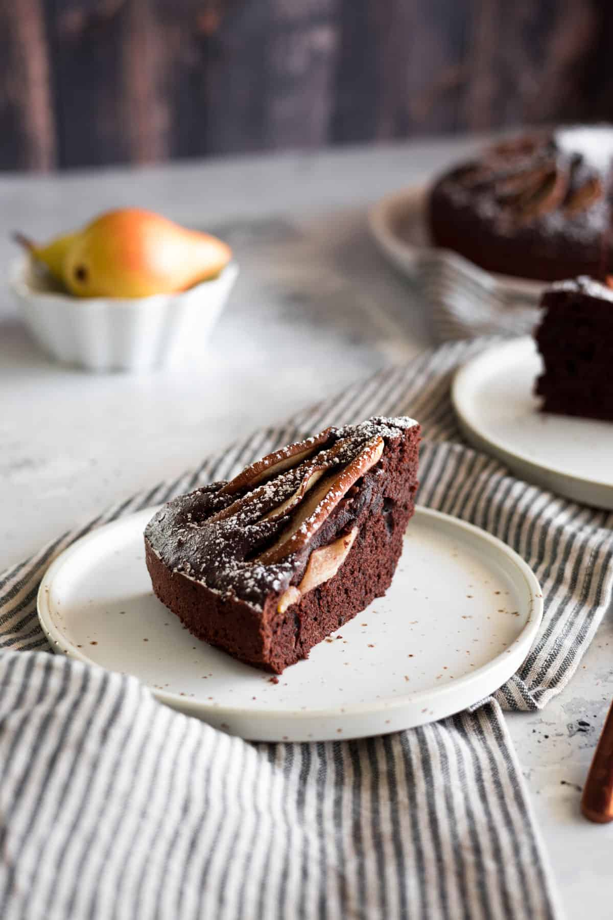 a slice of pear and chocolate cake