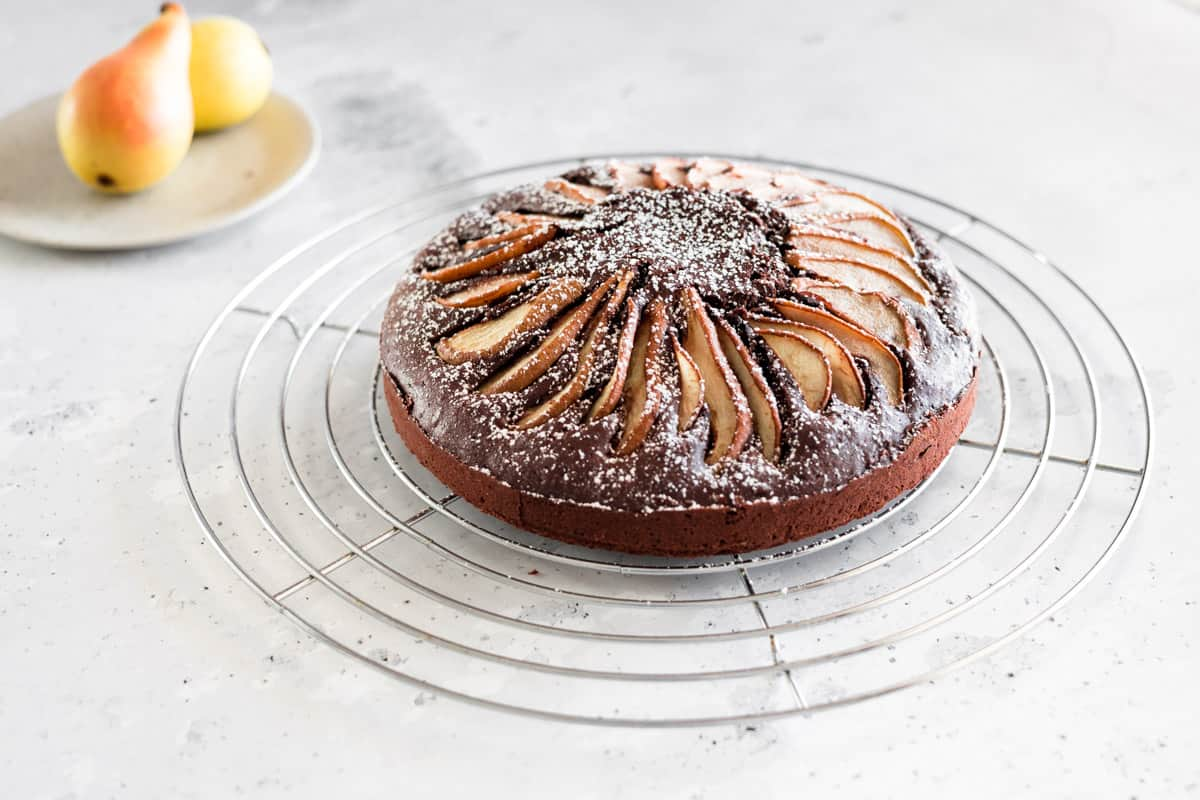 pear chocolate cake dusted with powdered sugar
