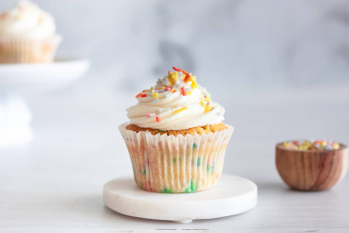 one confetti cupcake with mascarpone frosting