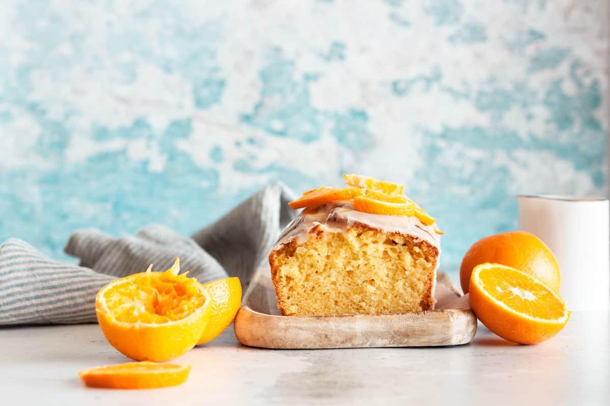 orange loaf cake on a wooden board