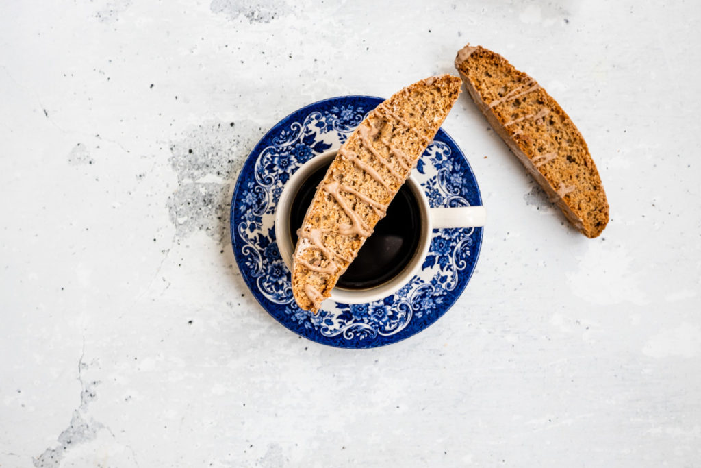 spiced chai biscotti on a cup of coffee